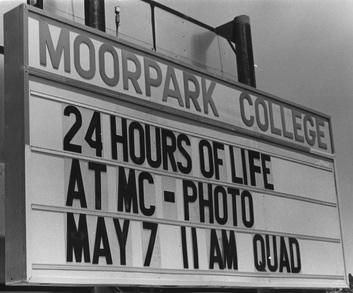 Sign for 24 hours of life at MC-Photo event.